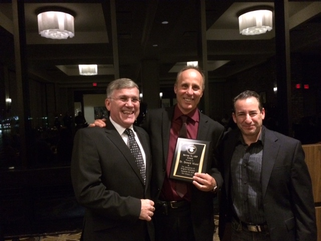 Dr. Raymond Monsell (left) and Dr. Rick Weinstein (right) presenting Dr. Don Muzzi with the ARP  2015 Service Award